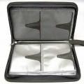 Anderes Behältnis, sog. Mäppchen für DVD/CD, siehe Photo,  - mit einer Außenseite aus Spinnstoffen, - mit einer Größe von ca. 16 x 29 x 5 cm, - mit einer angenähten Trageschlaufe aus Spinnstoffen, -...