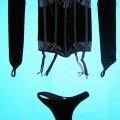 Warenzusammenstellung bestehend aus einer anderen Miederware, einem slipähnlichen  Kleidungsstück und Bekleidungszubehör (Armstulpen) sog. Korsett mit Handstulpen und Damenslip, Hersteller-Artikelnummer...