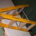 FIBRE GLASS AND ALUMINIUM STEP LADDER. THE LADDER TREADS ARE MADE OF ALUMINIUM BUT THE PRODUCT IS PRIMARILY FIBRE GLASS.