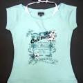 Pulloverähnliches Kleidungsstück, sog. T-Shirt, DBL Order No. 228391, Größe 36, siehe Foto - aus verschiedenen, einfarbigen Gewirken aus lt. Antrag 100 % Baumwolle, - über die Taille reichend...