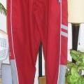 pantalon; tissu; à la taille; avec poche; avec ourlet; à la base;…