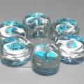 Nichtelektrischer Beleuchtungskörper, anderweit weder genannt noch inbegriffen, nicht handgearbeitet, sog. Teelichthalter aus Glas.  Es handelt sich um einen ca. 2,5 cm dicken, runden (Durchmesser...
