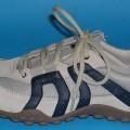 Trainingsschuhe (lt. Antrag Herrenschuhe, Art.-Nr. 7613901), siehe Foto,  - mit Laufsohlen aus Kunststoff (lt. Antrag),  - mit Oberteil (geschlossenes Blatt) aus Leder (den größten Teil der...
