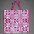Einkaufstasche, siehe Photo, - mit einer Außenseite aus Kunststofffolie, -- mit bloßem Auge wahrnehmbar, -- auf einer Unterlage aus Streifengewebe, - mit den Abmessungen 44 (H) x 50 (B) x 20...