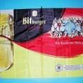 Andere konfektionierte Spinnstoffware, sog. Fahne mit Werbeaufdruck, siehe beigefügtes Foto, - rechteckig, in den Abmessungen: ca. 115 cm x 80 cm, - aus 0,1 mm dicken, bedruckten Geweben (in...