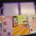 A PLAYSET CONSISTING OF A BOOK, 60 PUSH OUT MAGNETS OF BARBIE WITH SEVERAL OUTFITS THAT SHE CAN WEAR, AND 8 BACKGROUNDS. PACKAGED TOGETHER IN A PLASTIC CASE WITH TWO MAGNETIC STRIPS ON THE INSIDE...