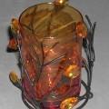 Ziergegenstand aus Glas, sog. Tischleuchter, siehe Photo, - zusammengesetzte Ware, bestehend aus - gewöhnlichem, orange gefärbtem Glas in Form eines Trinkglases, -- mit einem Durchmesser von...