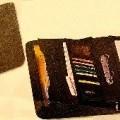 de cuir; avec poche; avec fermeture à glissière; avec poignée;…