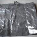 af tekstilmateriale; med lynlås; beholdere; med hank, tasker
