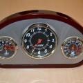 van hout; klokwerk; thermometers; in een behuizing