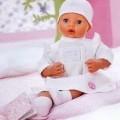 """Sog. """"Baby Annabell, happy winter holiday classic set"""". Es handelt sich um eine Kombination aus Puppenzubehör in Form von Bekleidung und einem Buch. Das Puppenzubehör besteht im Wesentlichen..."""