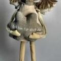 Andere konfektionierte Ware (Dekorationsfigur), sog. Schutzengel, Foto siehe Anlage, - in Form eines etwa 25 cm großen, stilisierten Mädchens, das einen Stern in den Händen hält, - laut Antrag...