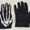 Fingerhandschuhe, sog. Halloween Handschuhe, Foto siehe Anlage, - als Fünffingerhandschuhe abgepasst hergestellt, - aus ca. 0,5 mm dicken, einfarbigen Gewirken aus laut Antrag Polyester (synthetische...