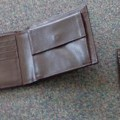 a pvc men's wallet put up for retail in a set with a pvc…