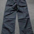 A PAIR OF WATERPROOF TROUSERS FOR UNISEX. THE ARTICLE REACHES DOWN TO THE ANKLE. HAS AN ELASTICATED WAIST WITHOUT OPENING, WITHOUT FASTENING WITH A DRAWSTRING TIE.  MADE UP OF A WOVEN NYLON FABRIC...