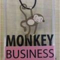 A MOBILE PHONE PROTECTIVE CASE. MADE FROM A MOULDED PLASTIC THERMOPLASTIC POLYURETHANE WHICH IS TRANSPARENT IN COLOUR WITH A PRINT OF A SWINGING MONKEY. CASE COVERS BACK AND SIDES WITH NO CLOSURE OR CLASP.