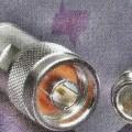 Koaxialsteckverbinder, Artikelnummer: 0731000770, - im Wesentlichen bestehend aus einem spezifisch geformten Metallgehäuse,  - mit einem N-Stecker auf der einen Seite und einer Anschlussvorrichtung...