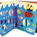 of textile material; put up for retail sale; for babies; books;…