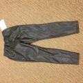 lange broeken; voor uniseks; van polyester; gebreid; omgezoomd;…